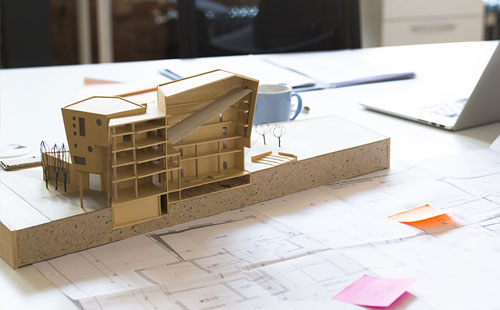 Architectural building model and blueprints