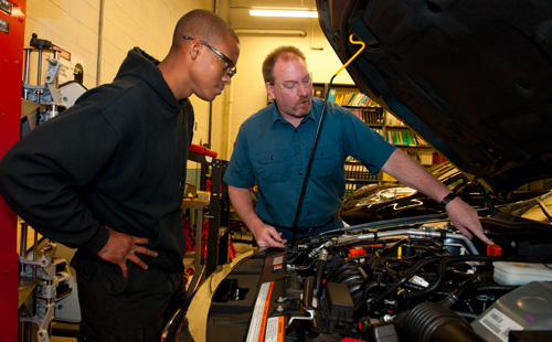 Student and instructor in Automotive Lab
