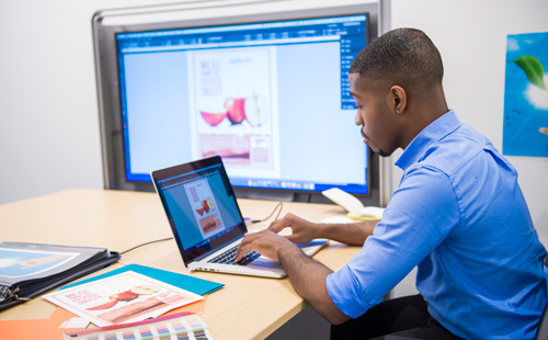student working with computer graphics