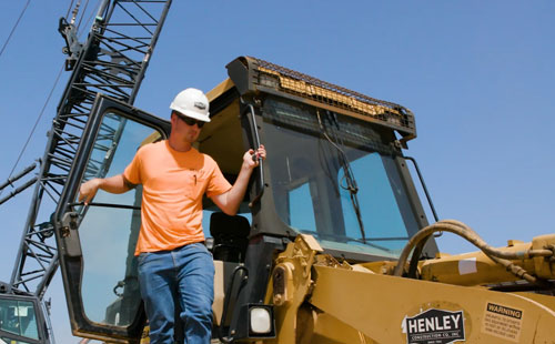 Construction manager working with heavy equipment