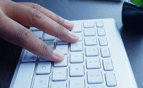 hand on a computer keyboard image