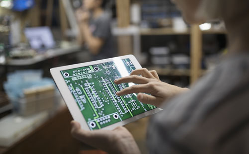 Engineer examining digital circuit board