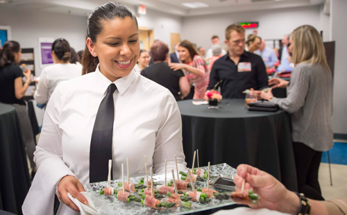 MC Hospitality student serving