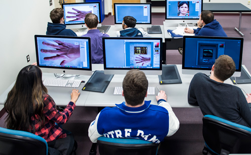 Graphic design classroom with computers image
