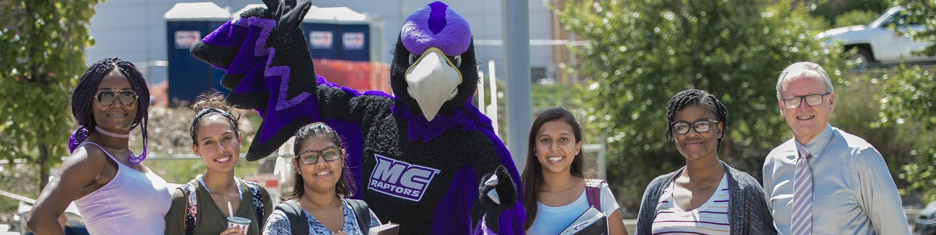 Students on campus with the Raptor and Dr. Cain