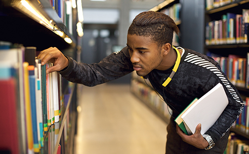Young male student in the library